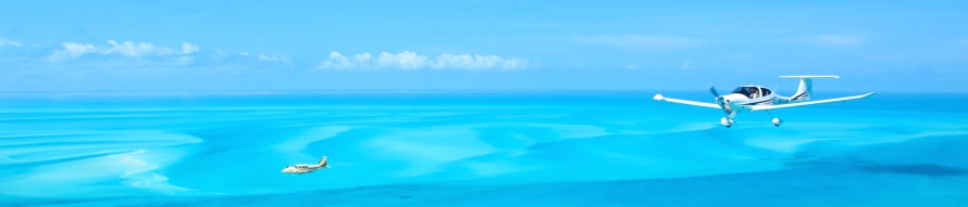 bahamas da40 and aztec over water banner thin flipped