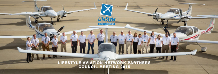 LfieStyle Flight Center Group Shot with planes Jan 2015 behind wing